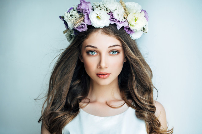 Beautiful girl with flower wreath
