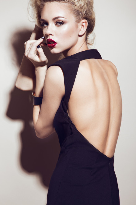 Beautiful sexy blonde girl with sensual lips, fashion hair, black