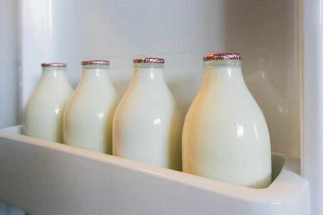 Milk Bottles in Fridge Door