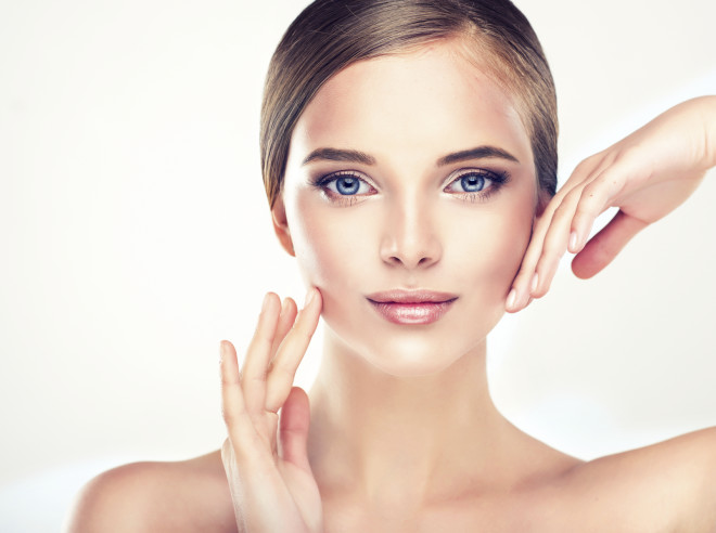 Young Woman with Clean Fresh Skin.
