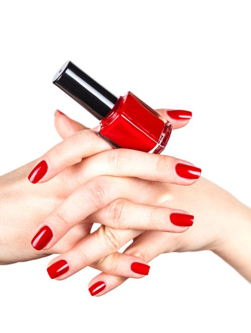 Red nail polish in a hands