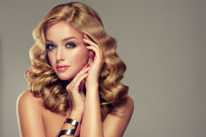 Beautiful girl blonde with an elegant hairstyle.