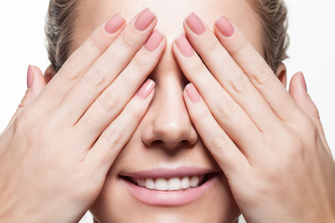 Woman with beautiful natural manicure and perfect clean skin