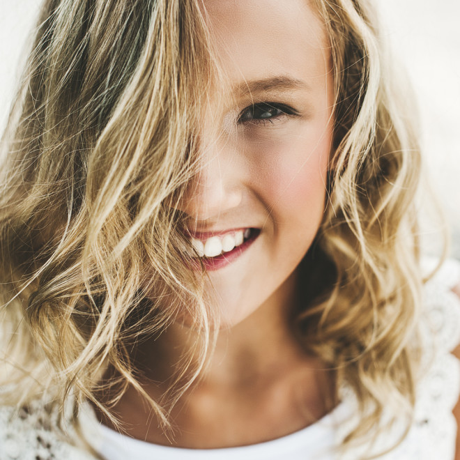 Adorable girl with hair in her face