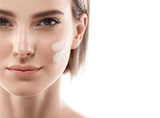 Perfect makeup. Skin tone cream lines on woman face.