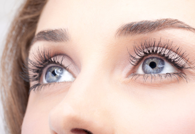 Close-up of woman's grey eyes with mascara