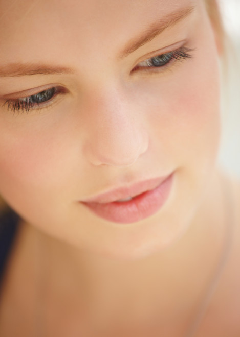 Close-up of a beautiful young woman looking down
