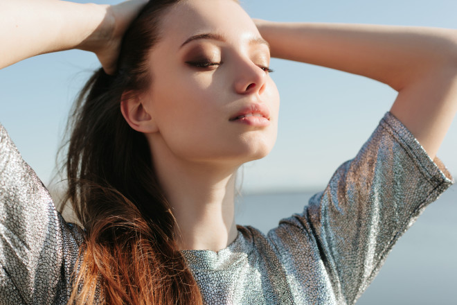 Beautiful girl enjoying the sun and the warmth