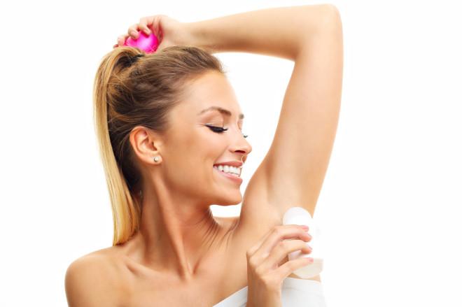 Adult woman using deodorant