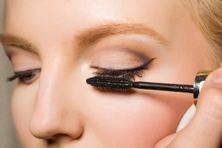 Close-up of a female applying make-up
