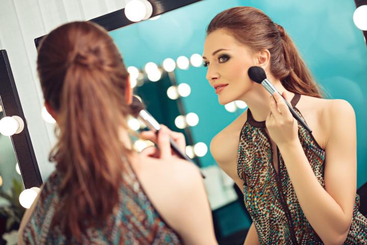 Woman applying blush or powder