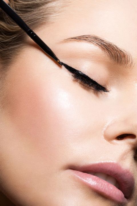 Close-up make-up with black eyeliner