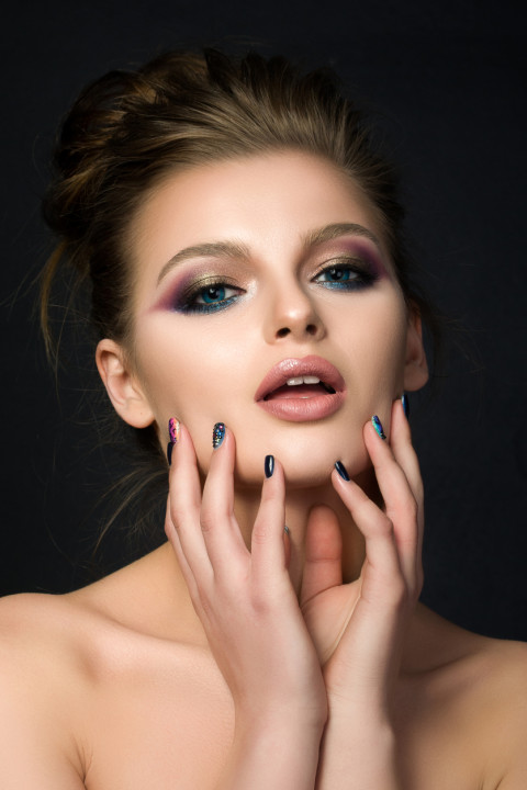 Portrait of young beautiful woman with blue eyes