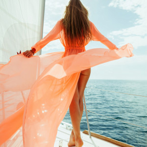 sexy woman in swimwear pareo yacht sea cruise vacation