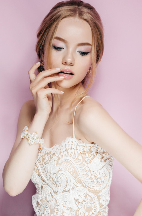 Portrait of Beautiful Young Fashion Sexy Bride Isolated . Jewelry and