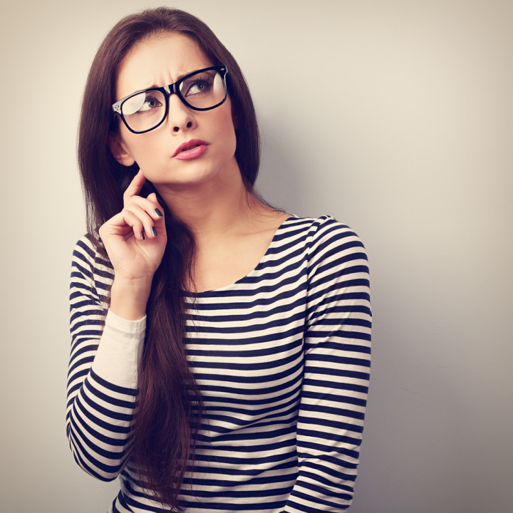 Annoyed angry young woman in eyeglasses