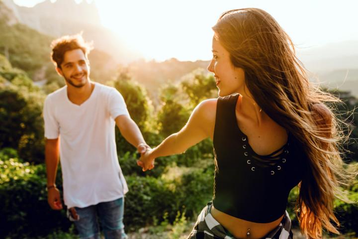 beautiful young couple enjoying nature