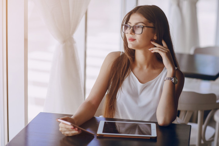 beautiful business lady uses different gadgets