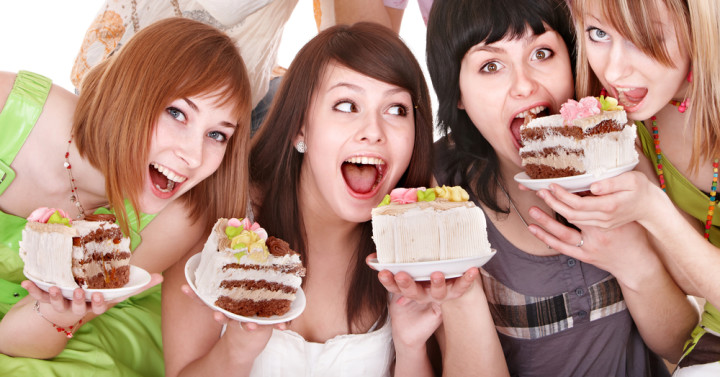 Group of happy young people with cake