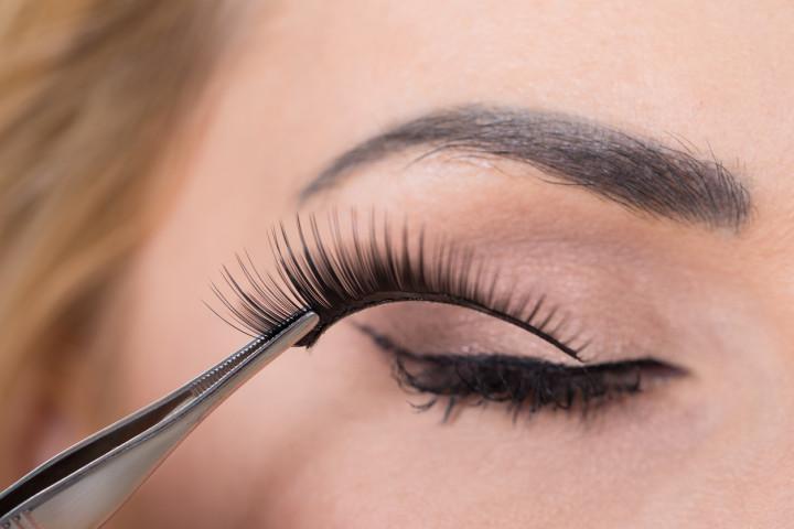 False Eyelashes Being Put On Woman's Eye
