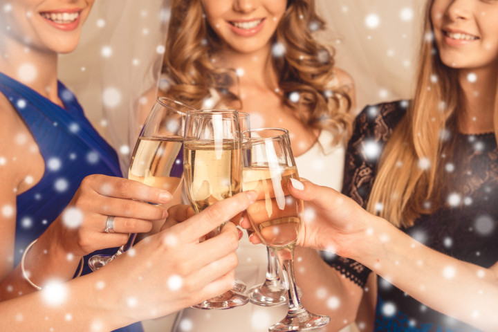 Cheers! Happy girlfriends having new year party and drinking shampagne