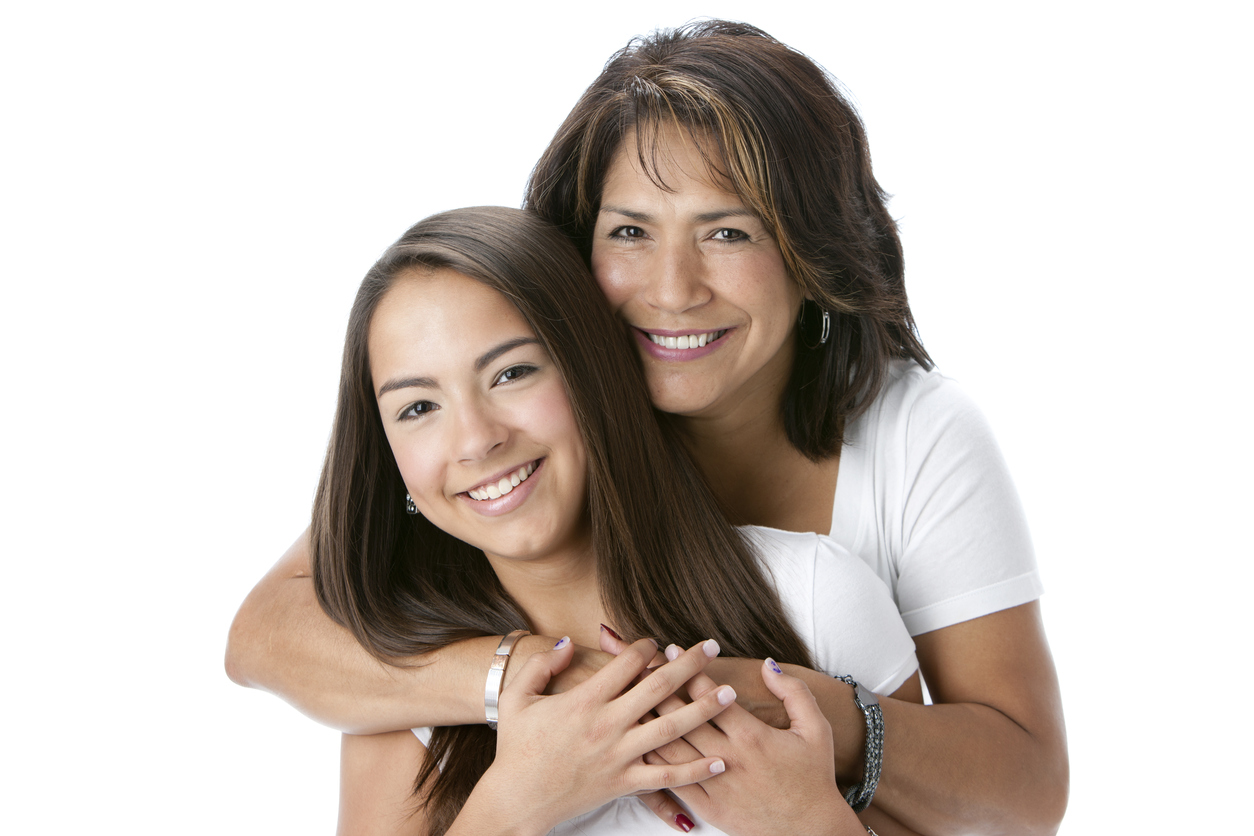 Real People: Head Shoulders Smiling Hispanic Mother and Teenage Daughter