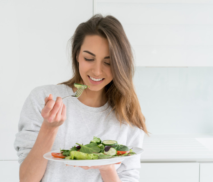 Woman dieting and eating a salad